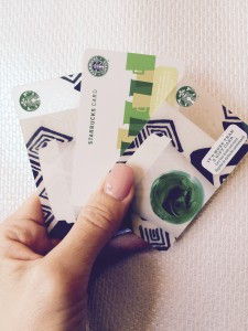 Woman holding starbucks giftcards